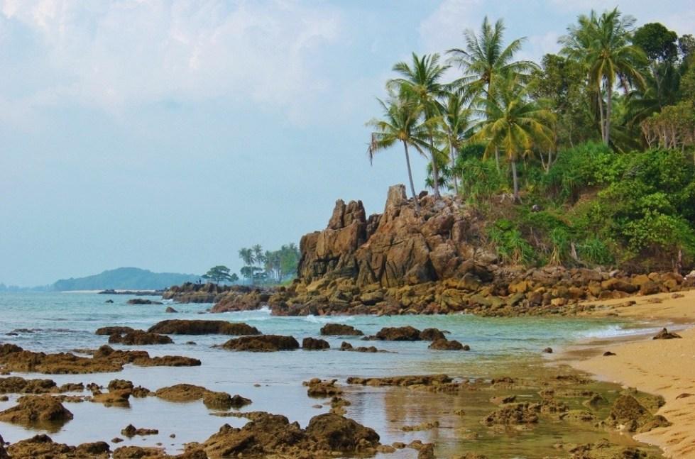 Rocky shoreline of Klong Khong Beach in Koh Lanta, Thailand