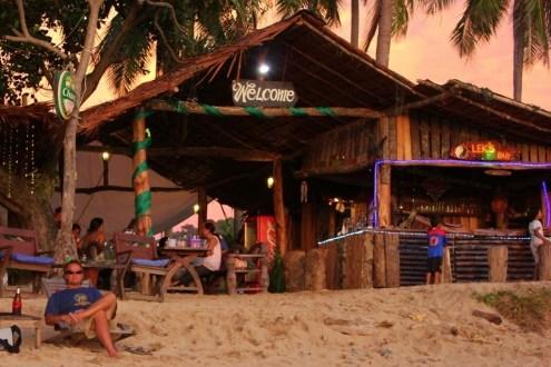 Sunset happy hour drinks at beach bar on Klong Khong Beach in Koh Lanta, Thailand
