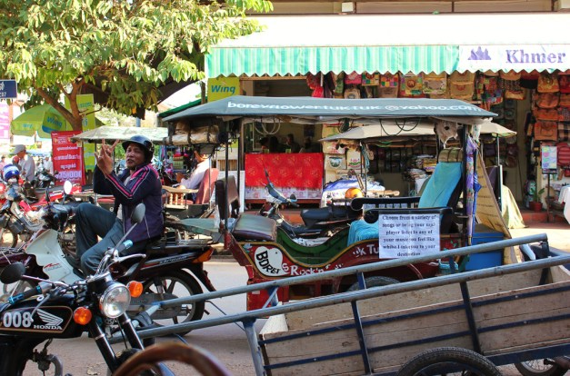 Tuk Tuk driver gives Peace Sign in Siem Reap, Cambodia