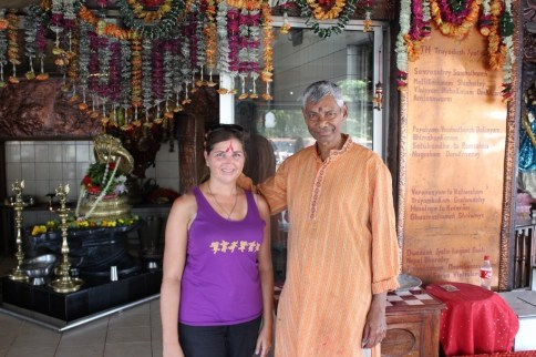 Man gives Hindu blessing at Grand Bassin Temple in Mauritius