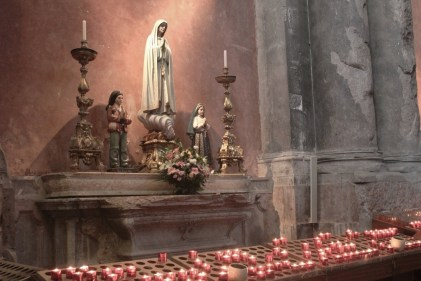 Lit Candles at Virgin Mary Statue in Igreja de Sao Domingos in Lisbon, Portugal