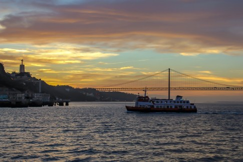 Ferry boat on Tagus River at Sunset in Lisbon, Portugal