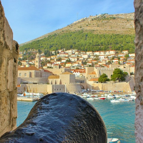 Cannon defending Old Town Dubrovnik with view of Mount Srd