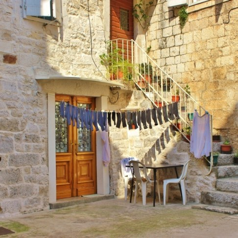 Laundry hanging in small courtyard in Trogir, Croatia