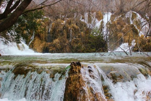 Water spilling over a rock in Plitvice Lakes National Park in Croatia