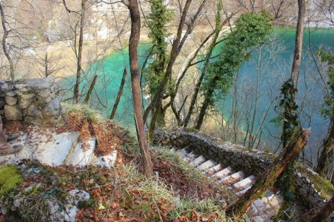 Plitvice Lakes: moss covered stairs led from the western edge of the canyon down to the misty base of Veliki Slap (the Big Waterfall)