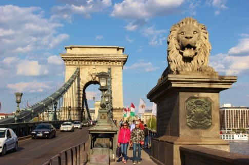 Iconic Budapest sights: Chain Bridge and one of the lions that guards it.