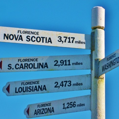 Visiting Kris's parents in Florence, Oregon: A street sign shows how far we are from 'Florences' around the world!