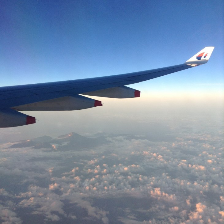 Flying over Indonesia on Malaysia Airlines during our Epic Travel Day