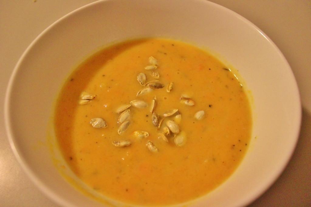 Homemade pumpkin soup with pumpkin seed topping