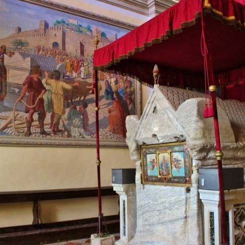 St. Euphemia's tomb and a painting depicting the story of how the tomb arrived in Rovinj, Croatia at St. Euphemia Church
