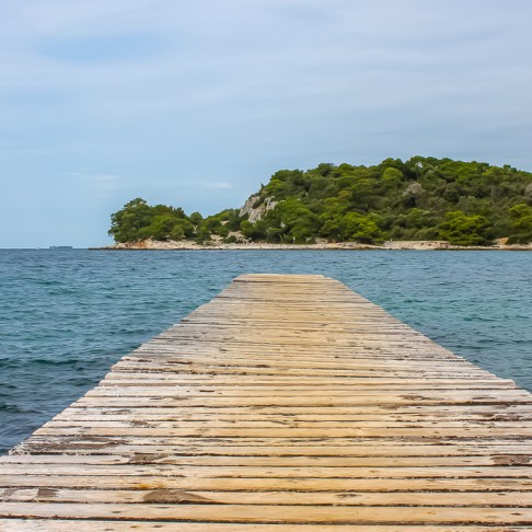 Boardwalk in Golden Cape Forest Park in Rovinj, Croatia