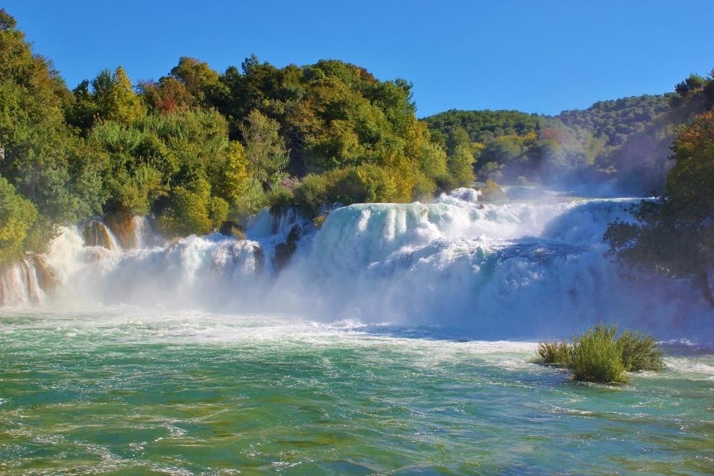 An afternoon sun highlights the gushing Skradinski buk waterfall at Krka National Park
