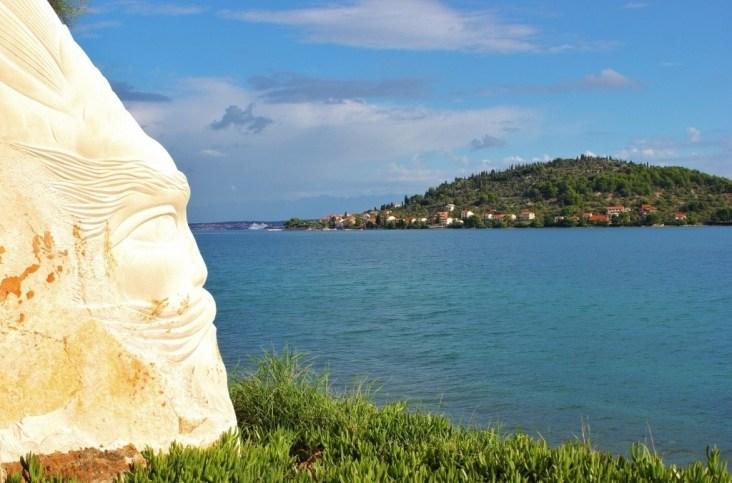 Face sculpture on shore of Ugljan, Croatia
