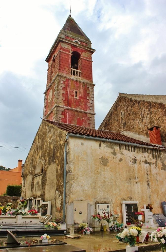 Pink bell tower in Preko on Ugljan, Croatia