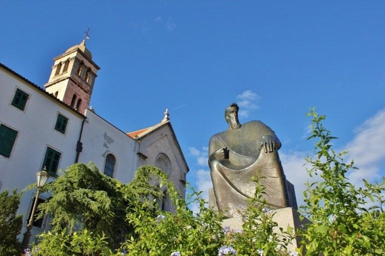 Statue and St. Francis Church in Sibenik, Croatia