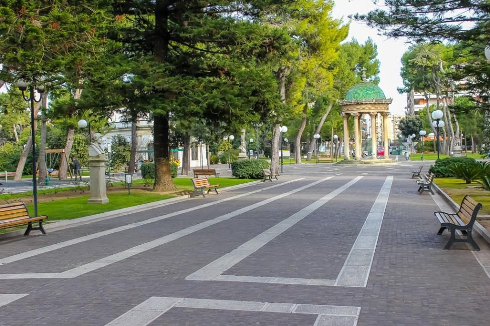 Walking path and gazebo in Giuseppe Garibaldi Garden Park in Lecce, Italy
