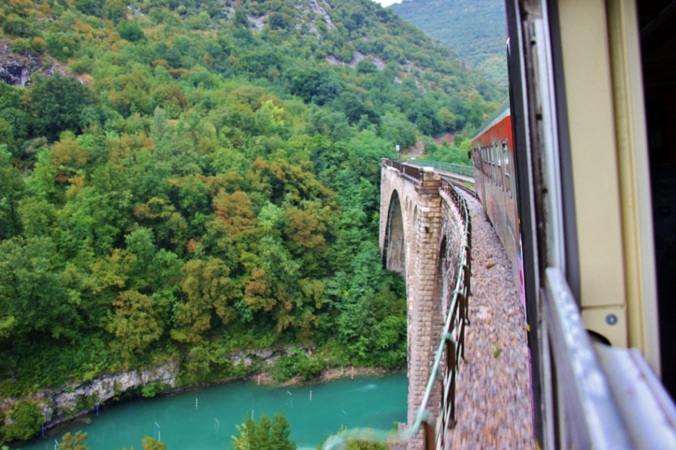 Crossing the Solkan Bridge over the Soca River on scenic train in Slovenia, Bohinj Railway