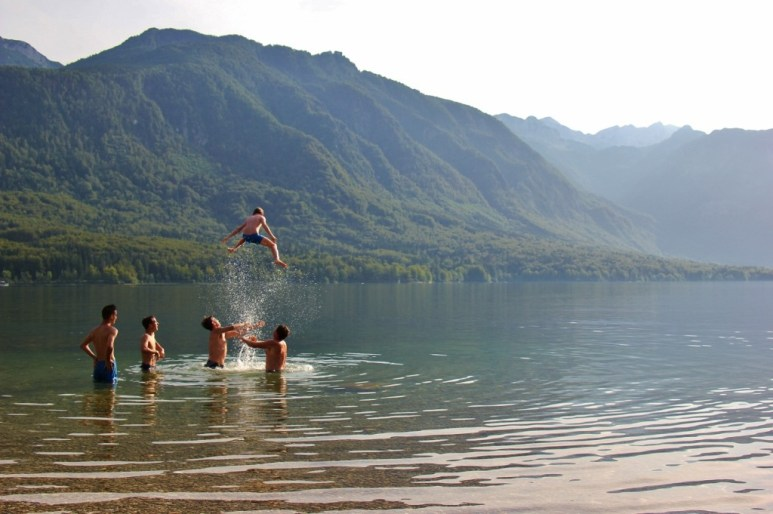 Kids swimming in Lake Bohinj, Slovenia