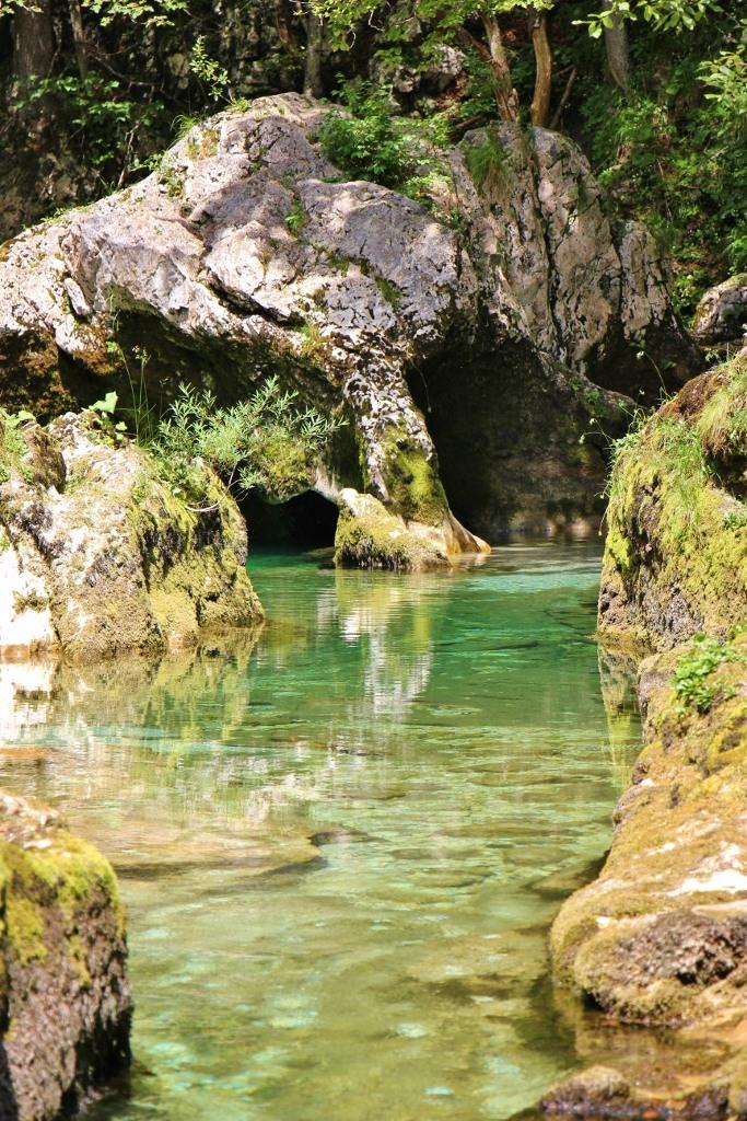 Clear water runs through Voje Valley and Mostnica Gorge Hiking Trails near Lake Bohinj, Slovenia