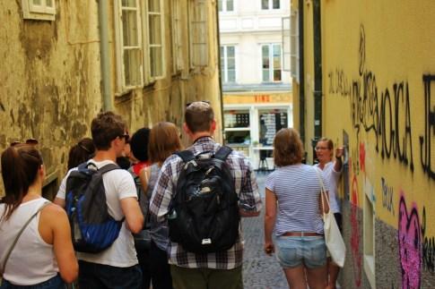 Looking at graffiti on the Ljubljana Graffiti Tour in Ljubljana, Slovenia