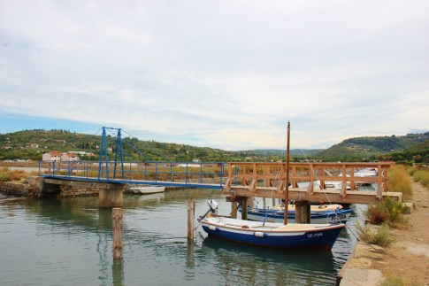 Bridge and boats at Strunjan Salt Works in Slovenia
