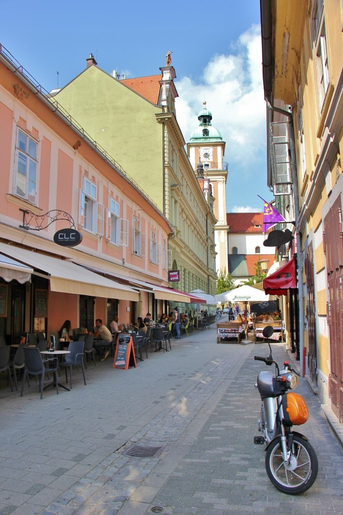 Outdoor cafes line Postna Street in Maribor, Slovenia
