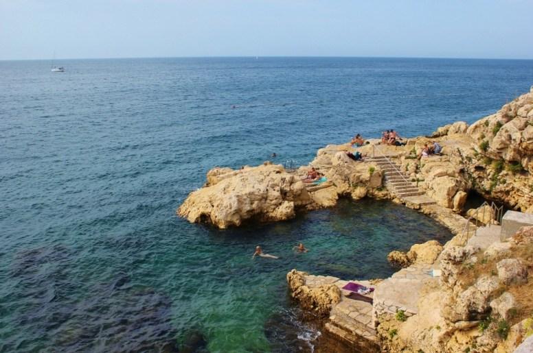 Rocky shoreline and blue Adriatic Sea at Rovinj, Istria, Croatia