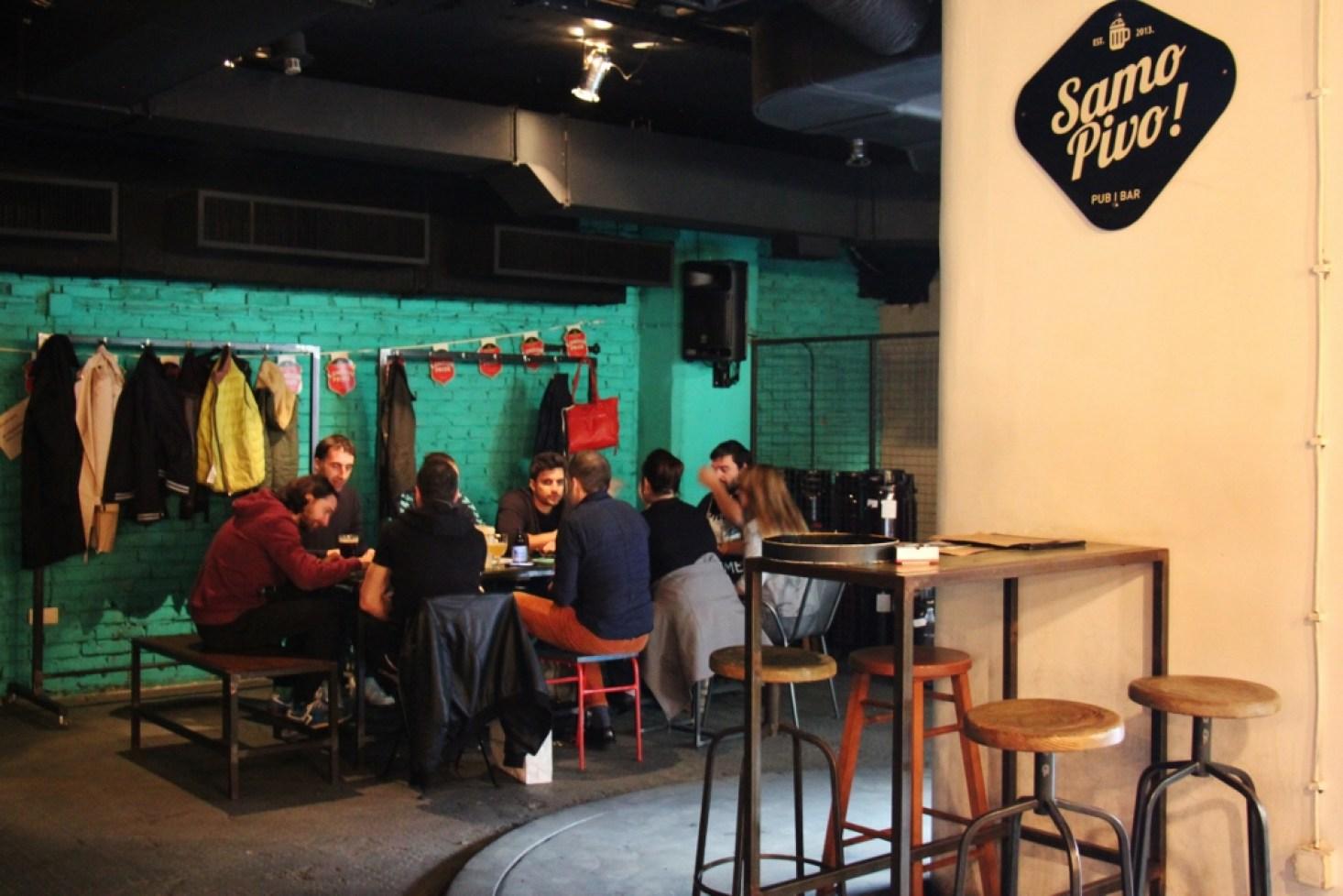Patrons at Samo Pivo craft beer bar in Belgrade, Serbia
