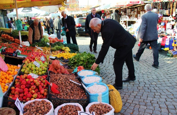 Man shops at Green Market in Prishtina, Kosovo