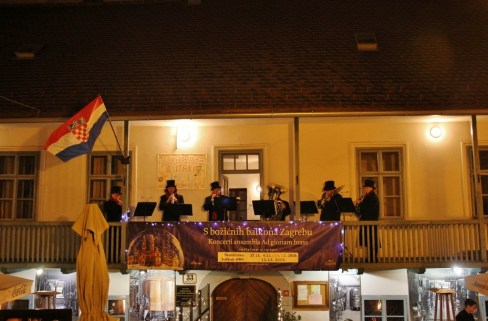 Ad Gloriam Brass Ensemble performs from a balcony during Christmas in Zagreb, Croatia