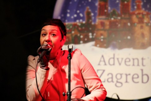 Woman sings at Advent celebration during Christmas in Zagreb, Croatia
