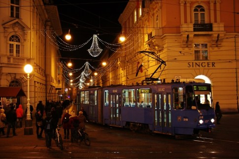 A tram under Christmas lights during Advent in Zagreb, Croatia