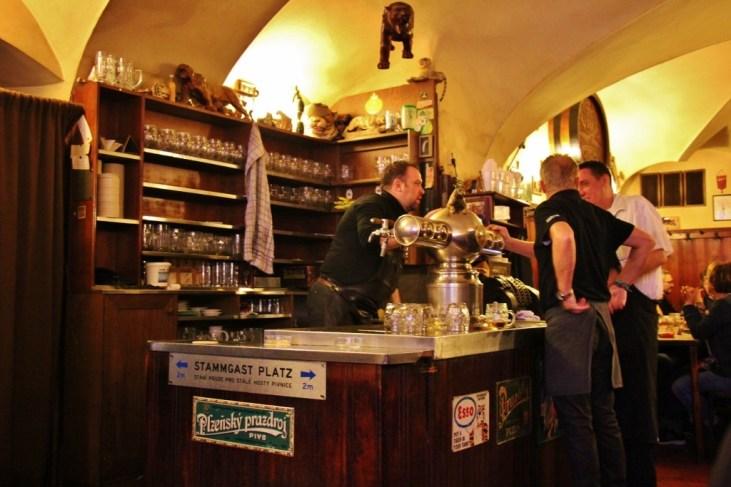 Bartender and waiters at U Zlateho Tygra Beer Hall, Prague, Czech Republic