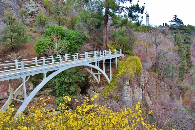 White arch bridge at National Botanical Garden of Georgia, Tbilisi, Georgia