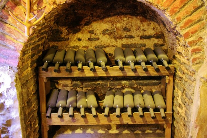 Rows of Dusty wine bottles at Karalashvili's Wine Cellar, Tbilisi, Georgia
