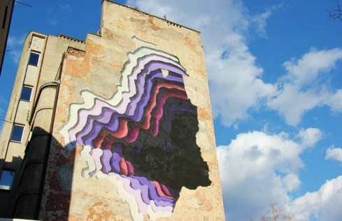 The Hole, Dziura w calym, Wall mural street art in Praga neighborhood in Warsaw, Poland