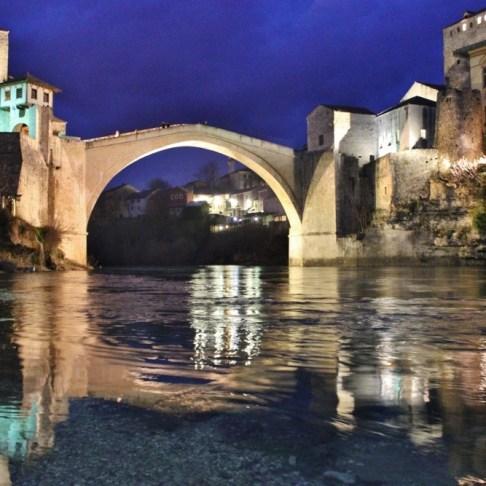 Neretva River and Old Bridge at night in Mostar, Bosnia-Herzegovina