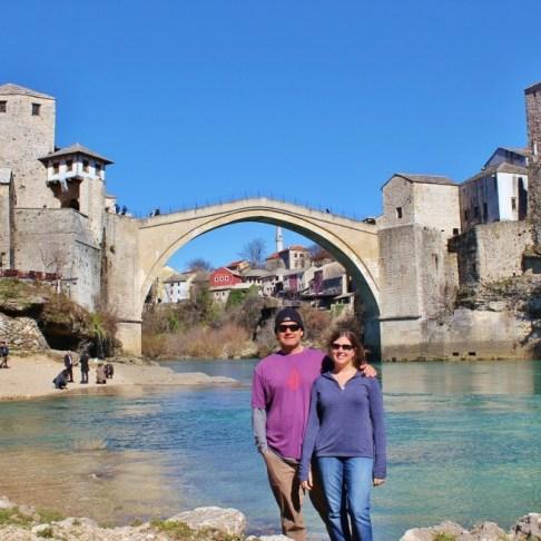 Posing for photo below Old Bridge in Mostar, Bosnia-Herzegovina