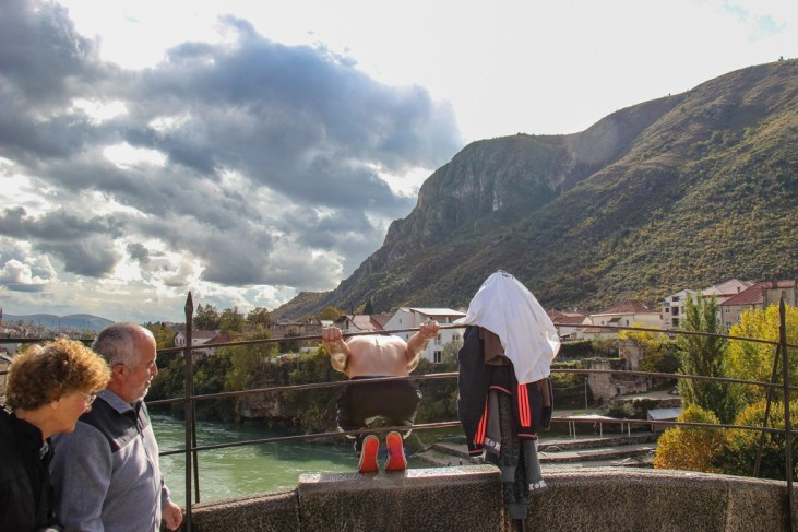 Man prepares to dive from Old Bridge in Mostar, Bosnia and Herzegovina
