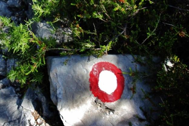 Red and white circle trail marker on Vidova Gora, on Brac, Croatia