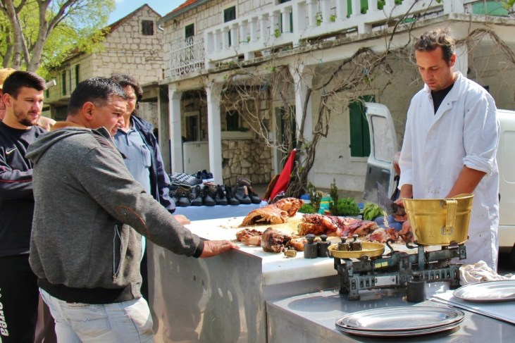 Roasted meat for sale at Zadvarje village Tuesday Market, Makarska, Croatia