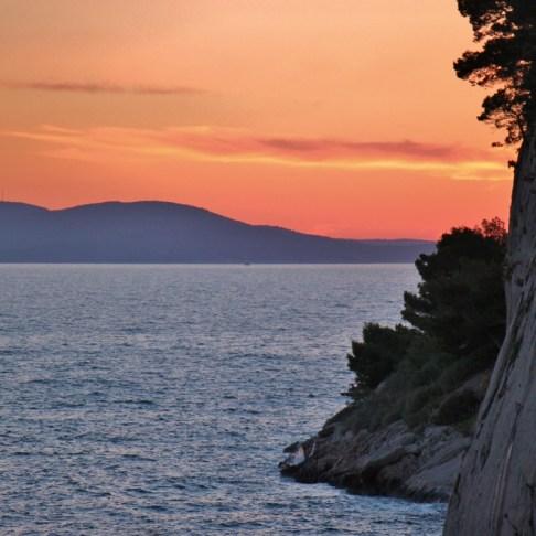 Hazy sunset behind St. Peter's Peninsula, Makarska, Croatia