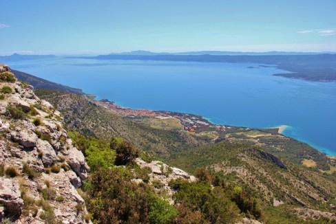 View of Bol and Zlatni Rat Beach from Vidova Gora peak on Brac, Croatia