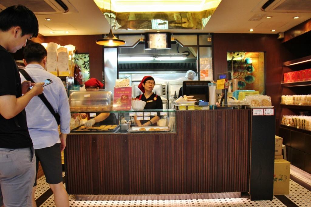 Women sell Egg Tarts at Tai Cheong Bakery in Central Hong Kong