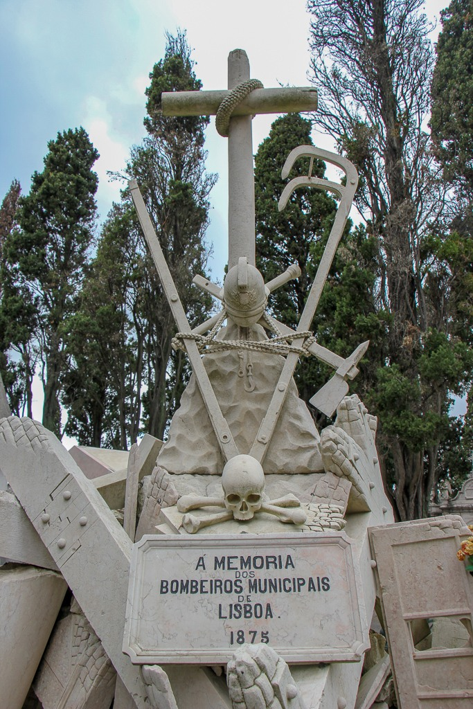 a memorial to firefighters at Cemiterio dos Prazeres, Lisbon, Portugal