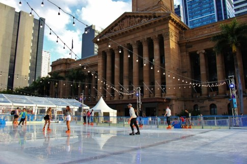 Ice skating at outdoor rink on King George's Square for Winter Festival in Brisbane, Australia