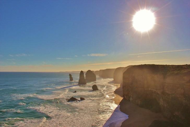 Sun shining on 12 Apostles rock formations, Great Ocean Road, Australia, JetSettingFools.com