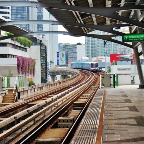 Train arriving at BTS Skytrain station in Bangkok, Thailand