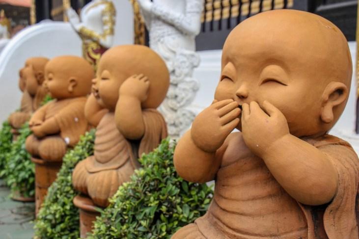 Laughing baby Buddha statues at Wat Inthakhin Sadue Muang in Chiang Mai, Thailand